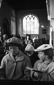 Young sisters in their Sunday best clothes, church service Aldeburgh Suffolk 1957 - Kurt Hutton - 1950s,1957,Anglican,belief,child,CHILDHOOD,children,Christian,christianity,christians,church,Church of England,church service,churches,clothes,Cof E,cofe,congregation,conviction,faith,female,females,g