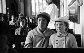 Aldeburgh Suffolk 1957 Young sisters in their Sunday best clothes at a Church of England church service - Kurt Hutton - 1950s,1957,Anglican,belief,child,CHILDHOOD,children,Christian,christianity,christians,church,Church of England,church service,churches,clothes,Cof E,cofe,congregation,conviction,faith,female,females,g