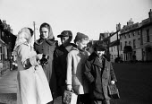 Children waiting for their school bus Aldeburgh Suffolk 1957 - Kurt Hutton - 1950s,1957,BAME,BAMEs,black,BME,bmes,boy,boys,bus,bus service,Bus Stop,buses,change,child,CHILDHOOD,children,diversity,EDU,educate,educating,education,educational,ethnicity,female,females,girl,girls,j