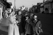 Children waiting for their school bus Aldeburgh Suffolk 1957 - Kurt Hutton - 1950s,1957,boy,boys,bus,bus service,Bus Stop,buses,change,child,CHILDHOOD,children,EDU,educate,educating,education,educational,female,females,girl,girls,juvenile,juveniles,kid,kids,knowledge,learn,lea