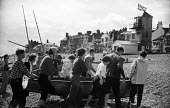 Small sailing yachts on the beach, Aldeburgh Regatta Suffolk 1957 - Kurt Hutton - 1950s,1957,adolescence,adolescent,adolescents,beach,BEACHES,boat,boats,boy,boys,carries,carry,carrying,child,childhood,children,COAST,female,females,girl,girls,hobbies,hobby,hobbyist,holiday,holiday m