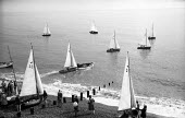 Small sailing yachts on the beach, Aldeburgh Regatta Suffolk 1957 - Kurt Hutton - 1950s,1957,beach,BEACHES,boat,boats,COAST,hobbies,hobby,hobbyist,holiday,holiday maker,holiday makers,holidaymaker,holidaymakers,holidays,leisure,LFL,LIFE,lifestyle,OCEAN,PEOPLE,person,persons,RECREAT