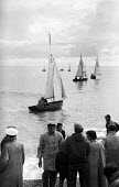 Small sailing yachts on the beach, Aldeburgh Regatta Suffolk 1957 - Kurt Hutton - 1950s,1957,beach,BEACHES,boat,boats,COAST,FEMALE,hobbies,hobby,hobbyist,holiday,holiday maker,holiday makers,holidaymaker,holidaymakers,holidays,leisure,LFL,LIFE,lifestyle,male,man,men,OCEAN,PEOPLE,pe