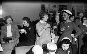 Aldeburgh Suffolk 1957. Women enjoying cocktails in a bar at the end of the annual Carnival and Regatta day - Kurt Hutton - 1950s,1957,alcohol,Aldeburgh,BAME,BAMEs,black,Black and White,BME,bmes,cocktail,cocktails,communicating,communication,conversation,conversations,dialogue,discourse,discuss,discusses,discussing,discuss