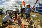Kids Area, Tolpuddle Martyrs Festival, Dorset. - Jess Hurd - 2010s,2019,child,childhood,children,Dorset,FEMALE,Festival,FESTIVALS,juvenile,juveniles,kid,kids,Kids Area,member,member members,members,people,person,persons,play,playing,sand pit,Tolpuddle Martyrs F
