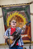 Performer Robb Johnson, Tolpuddle Martyrs Festival, Dorset. - Jess Hurd - 2010s,2019,ACE,Arts,banner,banners,Culture,Dorset,Festival,FESTIVALS,guitar,guitars,melody,member,member members,members,music,MUSICAL,musical instrument,musical instruments,musician,musicians,PEOPLE,