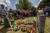 Angela Rayner MP wreath laying, Tolpuddle Martyrs Festival, Dorset. - Jess Hurd - 2010s,2019,Angela Rayner,cemeteries,cemetery,dead,death,deaths,died,Dorset,FEMALE,Festival,FESTIVALS,floral tribute,floral tributes,flower,flowering,flowers,grave,graves,gravestone,gravestones,graveya