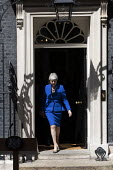 Theresa May leaving 10 Downing Street for her last PMQ time before resigning, Westminster, London - Jess Hurd - 2010s,2019,CONSERVATIVE,Conservative Party,conservatives,Downing Street,female,leaving,London,MP,MPs,people,person,persons,POL,political,politician,politicians,Politics,resignation,resigning,Street,Th