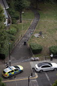 Stabbing crime scene with pool of blood visible on an E3 estate, Tower Hamlets, East London. 16 year old victim received non life threatening injuries - Jess Hurd - 2010s,2019,adolescence,adolescent,adolescents,adult,adults,assault,assaults,attack,attacking,attacks,blood,CAR,cars,cities,City,CLJ,crime,E3,East London,estate,ESTATES,force,gang,inner city,knife crim