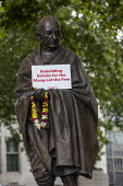 Mahatma Gandhi statue with Labour Party placard Labour Party General Election Now Rally, Parliament Square, Westminster, London - Jess Hurd - 2010s,2019,activist,activists,against,CAMPAIGNING,CAMPAIGNS,DEMONSTRATING,Demonstration,Gandhi,General Election Now,Labour Party,London,Mahatma Gandhi,Parliament,Parliament Square,Party,placard,PLACAR