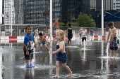 Heatwave. Children playing with water jets, Centenary Square, Birmingham, reflection pool with fountains - John Harris - 2010s,2019,BAME,BAMEs,Birmingham,Black,Black and White,BME,bmes,boy,boys,child,CHILDHOOD,Children,clean,diversity,ethnic,ethnicity,female,females,fountain,fountains,girl,girls,having fun,heat,holiday,