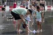 Heatwave. Children playing with water jets, Centenary Square, Birmingham, reflection pool with fountains - John Harris - 2010s,2019,BAME,BAMEs,Birmingham,Black,Black and White,BME,bmes,boy,boys,child,CHILDHOOD,Children,clean,DAD,DADDIES,DADDY,DADS,diversity,ethnic,ethnicity,FAMILY,father,FATHERHOOD,fathers,female,female