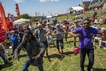 UNISON dancers, Tolpuddle Martyrs Festival, Dorset - Jess Hurd - 2010s,2019,BAME,BAMEs,Black,Black and White,BME,bmes,dance,dancer,dancers,dancing,diversity,Dorset,ethnic,ethnicity,FEMALE,Festival,FESTIVALS,member,member members,members,minorities,minority,multi cu