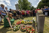 Angela Rayner MP laying a wreath at the grave of on the grave of James Hammett, Tolpuddle Martyrs Festival, Dorset. - Jess Hurd - 2010s,2019,Angela Rayner,cemeteries,cemetery,dead,death,deaths,died,Dorset,FEMALE,Festival,FESTIVALS,floral tribute,floral tributes,flower,flowering,flowers,grave,graves,gravestone,gravestones,graveya