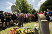 Mark Serwotka, PCS laying a wreath at the grave of on the grave of James Hammett, Tolpuddle Martyrs Festival, Dorset. - Jess Hurd - 2010s,2019,cemeteries,cemetery,dead,death,deaths,died,Dorset,Festival,FESTIVALS,floral tribute,floral tributes,flower,flowering,flowers,Gen Sec,grave,graves,gravestone,gravestones,graveyard,graveyards