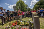 Jeremy Corbyn laying a wreath at the grave of on the grave of James Hammett, Tolpuddle Martyrs Festival, Dorset - Jess Hurd - 2010s,2019,cemeteries,cemetery,dead,death,deaths,died,Dorset,Festival,FESTIVALS,floral tribute,floral tributes,flower,flowering,flowers,grave,graves,gravestone,gravestones,graveyard,graveyards,Jeremy