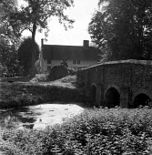 Bridge over River Brett and farmhouse, Chelsworth Suffolk 1955 - Kurt Hutton - 1950s,1955,bridge,bridges,building,buildings,calm,cottage,cottages,country,countryside,English heritage,ENI,environment,environmental Issues,farmhouse,folk,heritage,house,houses,Housing,idyll,idyllic,