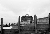 Martello Tower, seafront defences Aldeburgh Suffolk 1958 - Kurt Hutton - 1950s,1958,building,buildings,calm,coast,coastal,coasts,defence,DEFENSE,defenses,English heritage,ENI,environment,environmental Issues,folk,heritage,Martello Tower,Martellos,nature,OCEAN,peace,sea,Sea