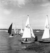 Aldeburgh Yacht Club preparing to sail, Suffolk 1958 - Kurt Hutton - 1950s,1958,boat,boating,boats,coast,coastal,coasts,hobbies,hobby,hobbyist,leisure,LFL,LIFE,male,man,men,PEOPLE,person,persons,preparing,RECREATION,RECREATIONAL,sail,sailing,Sailing Boat,Sailing boats,