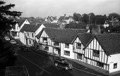 The Swan Hotel, High Street, mediaeval village of Lavenham, Suffolk 1958 - Kurt Hutton - 1950s,1958,AUTO,AUTOMOBILE,AUTOMOBILES,building,buildings,car,cars,country,countryside,English heritage,ENI,environment,environmental Issues,Half timbered houses,heritage,High Street,hotel,hotels,idyl