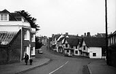 The High Street, mediaeval village of Lavenham Suffolk 1958 - Kurt Hutton - 1950s,1958,building,buildings,country,countryside,EBF,Economic,Economy,English heritage,ENI,environment,environmental Issues,Half timbered houses,heritage,High Street,history,home,homes,idyll,idyllic,