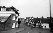 The High Street, mediaeval village of Lavenham Suffolk 1958 - Kurt Hutton - 1950s,1958,building,buildings,country,countryside,dog,DOGS,EBF,Economic,Economy,English heritage,ENI,environment,environmental Issues,Half timbered houses,heritage,High Street,history,home,homes,idyll