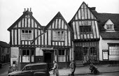 The Crooked House and Post Office, mediaeval village of Lavenham Suffolk 1958 - Kurt Hutton - 1950s,1958,bought,building,buildings,buying,consumer,consumers,country,countryside,customer,customers,EBF,Economic,Economy,English heritage,ENI,environment,environmental Issues,Half timbered houses,he