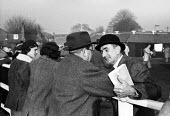 Tattersalls Newmarket Stables Cambridgeshire 1958, buyers in conversation at the annual bloodstock auction sales for racehorses - Kurt Hutton - 1950s,1958,animal,animals,auction,auctioneer,auctioneers,auctions,bloodstock,Bowler Hat,bowler hats,buy,buyer,buyers,buying,communicating,communication,conversation,conversations,country,countryside,d