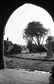 View of Orford from St Bartholomew's Church, Suffolk 1958 - Kurt Hutton - 1950s,1958,archway,building,buildings,calm,CEMETERY,christian,christianity,church,churches,churchyard,churchyards,country,countryside,English heritage,ENI,environment,environmental Issues,Half timbere