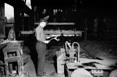 Steelworker, Dalzell Steel Mill Motherwell 1958 - Kurt Hutton - 1950s,1958,EBF,Economic,Economy,employee,employees,Employment,FACTORIES,factory,heat,hot working,job,jobs,LBR,maker,makers,making,male,man,manual labour,men,mill,mills,people,person,persons,plant,prod