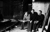 Steelworkers taking a tea break, Dalzell Steel Mill Motherwell 1958 - Kurt Hutton - 1950s,1958,break,break time,breaktime,communicating,communication,conversation,conversations,Dalzell Steel Works,dialogue,discourse,discuss,discusses,discussing,discussion,EBF,Economic,Economy,employe
