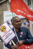 Protest against Universal Credit and holiday hunger, Unite Community National Day of Action against Poverty, St Pancras Church House foodbank, Trussell Trust, London. - Jess Hurd - 2010s,2019,activist,activists,against,banner,banners,CAMPAIGNING,CAMPAIGNS,Church,churches,communities,Community,DEMONSTRATING,demonstration,DEMONSTRATIONS,excluded,exclusion,food bank,foodbank,foodba