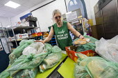 Helper at St Pancras Church House foodbank, Trussell Trust, London - Jess Hurd - 2010s,2019,age,ageing population,bag,bags,Church,churches,communities,Community,elderly,excluded,exclusion,FEMALE,food aid distribution,food bank,food banks,food parcel,foodbank,foodbanks,HARDSHIP,hel