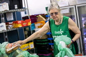 Helper at St Pancras Church House foodbank, Trussell Trust, London - Jess Hurd - 01-08-2019
