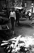 Local children playing around bonfire in adventure playground Notting Hill west London 1970Local children playing around bonfire in adventure playground Notting Hill west London 1970Local children pla... - Clive Capel - 14-05-1970