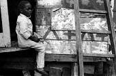 Young boy playing with toy gun in adventure playground Notting Hill west London 1970Young boy playing with toy gun in adventure playground Notting Hill west London 1970Young boy playing with toy gun i... - Clive Capel - 14-05-1970