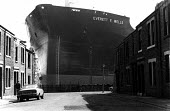 Everett F Wells oil tanker towering over terraced housing 1976, Swan Hunter shipyard, Wallsend. The last tanker built on the River Tyne - Ray Smith - 24-01-1976