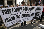 Free Tommy Robinson protest, BBC Portland Place, London. Banner claiming he is a political prisoner and jailed for journalism - Jess Hurd - 03-08-2019