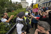 Argument between racists and anti racists. Stand Up to Racism counter protest against Free Tommy Robinson protest, BBC Portland Place, London - Jess Hurd - 03-08-2019