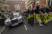 LAFA London Anti Fascist Assembly against Free Tommy Robinson protest, London. Passing a Daimler Limousine wedding car - Jess Hurd - 2010s,2019,activist,activists,against,Anarchism,Anarchist,Anarchists,anti fascist,Anti Racism,anti racist,Assembly,banner,banners,BBC,CAMPAIGNING,CAMPAIGNS,counter protest,DEMONSTRATING,demonstration,