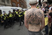Patriotic tattoo with British Bulldog, Winston Churchill quote and WW2. Free Tommy Robinson protest, BBC Portland Place, London - Jess Hurd - 03-08-2019