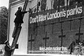 Ken Livingstone and Illtyd Harrington putting up a GLC billboard on the dangers of nuclear war, London 1983 - NLA - 31-05-1983