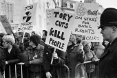 Anti cuts protest outside town hall, Maidstone, Kent, 1984 for visit of Margaret Thatcher. - NLA - 1980s,1984,activist,activists,against,CAMPAIGNING,CAMPAIGNS,cuts,DEMONSTRATING,Demonstration,Maidstone,Margaret Thatcher,member,member members,members,outside,people,placard,placards,Protest,PROTESTER