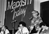 Eric Hobsbawm speaking Marxism Today joint Labour Party Communist Party meeting, London 1984 with Robin Cook (L) Harriet Harman and Beatrix Campbell (R) - NLA - 1980s,1984,banner,banners,Bea,Beatrix Campbell,communism,Communist Party,Eric Hobsbawm,Left,left wing,Leftwing,Leninist,London,Marxism Today,Marxist,Marxists,meeting,MEETINGS,Party,Robin Cook,socialis