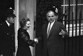 Margaret Thatcher welcoming German chancellor Helmut Kohl to Downing Street, London 1984 for economic summit - NLA - 1980s,1984,CONSERVATIVE,Conservative Party,conservatives,economic summit,greeting,Helmut Kohl,London,Margaret Thatcher,MP,MPs,POL,political,politician,politicians,Politics,Shaking Hands,Street,welcomi