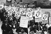 Protest against the US invasion of Grenada, London 1983. New Jewel Movement banner - Peter Arkell - 1980s,1983,activist,activists,against,american,americans,anti,banner,banners,CAMPAIGNING,CAMPAIGNS,DEMONSTRATING,Demonstration,FEMALE,Grenada,Grenadian,Grenadians,imperialism,intervention,Left,left wi