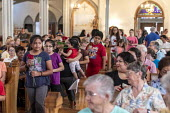 Detroit, Michigan, USA: Catholic mass for immigrant families that are separated or in detention. The event raised money for the Catholic Dioceses of El Paso and Brownsville for their work among immigr... - Jim West - 2010s,2019,America,american,americans,asylum,BAME,BAMEs,Belief,BME,bmes,border,Catholic,catholicism,Catholics,ceremonial,ceremonies,ceremony,child,CHILDHOOD,children,christian,christianity,christians,