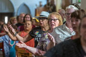 Detroit, Michigan, USA: Catholic mass for immigrant families that are separated or in detention. The event raised money for the Catholic Dioceses of El Paso and Brownsville for their work among immigr... - Jim West - 2010s,2019,America,american,americans,asylum,Belief,border,Catholic,catholicism,Catholics,ceremonial,ceremonies,ceremony,CHILD,CHILDHOOD,children,christian,christianity,christians,church,churches,conv