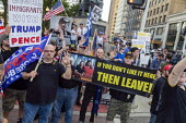 Detroit, Michigan, USA Donald Trump Supporters rally outside the first Democratic Presidential Debate. If You Don't Like It Then Leave! slogan with a photograph of Rashida Tlaib, Ilhan Omar, Alexandri... - Jim West - 30-07-2019