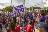 Detroit, Michigan USA: SEIU Security guards rally at the Labor Legacy Monument for union recognition at downtown buildings owned by businessman Dan Gilbert - Jim West - 2010s,2019,ACTIVIST,ACTIVISTS,against,America,american,americans,Bedrock,buildings,businessman,BUSINESSMEN,CAMPAIGN,campaigner,campaigners,CAMPAIGNING,CAMPAIGNS,Dan Gilbert,DEMONSTRATING,demonstration